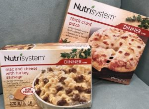 two boxes of nutrisystem meals site on a couch