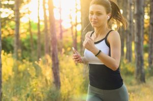 a woman runs while keeping track with her fitpoints