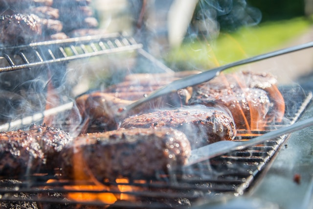 barbecue beef being cooked on the grill