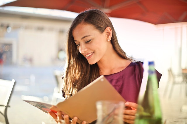 a woman looks at her dinner menu