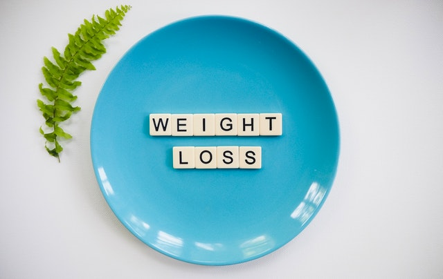 a plate with weight loss spelled on it
